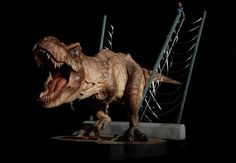 This exclusive and highly detailed scale statue features the female T-Rex as she roars in triumph after setting herself free from her pen as seen in the classic film Jurassic Park. Jurassic Park Film, Amblin Entertainment, Beautiful Film, Steven Spielberg, Classic Films, Universal Studios, T Rex, Lion Sculpture, Cinema