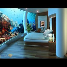 Poseidon Undersea Resorts!! With a button that feeds the fish.