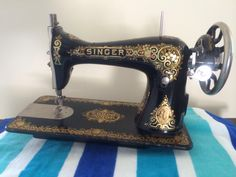 My Singer 15 from 1913. She has lovely Tiffany decals - my favorite! And she'll be back in her cabinet soon.