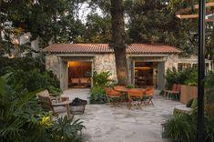 Marina Linhares Decoração de Interiores の トロピカルな 庭