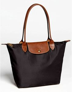 Longchamp 'Small Le Pliage' Shoulder Bag Versatile travel purses are a great choice for those looking for a little more space, or who want something similar to everyday function, all while blending in with the locals.