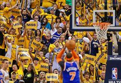 MISS IT Indiana Pacers fans cheer as New York Knicks Carmelo Anthony (7) shoots a free throw during the second half of Game 3 of an Eastern Conference semifinal NBA basketball playoff series on Saturday, May 11, 2013, in Indianapolis. Indiana defeated New York 82-71. (Darron Cummings/AP)  MORE NBA PLAYOFFS PHOTOS HERE