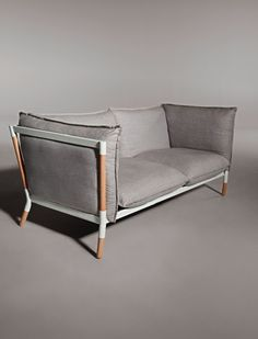 I am really intrigued by this frame design. I wonder if it's comfortable. I assume the back is solid otherwise this is really the ultimate loose-back couch.