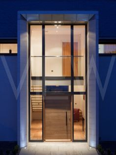 Contemporary Solid Front Door Dusk shot of entrance to a modern house Urban Front London UK 2012