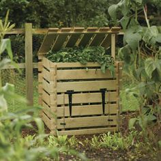 Attractice compost bin - couls probably make one like this out of old pallets and just make a hatch in the bottom of one to get to compost in bottom