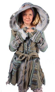 Thimbleweed is a dramatic pixie coat in shades of wintry sage wool with periwinkle seams and a zipper front.