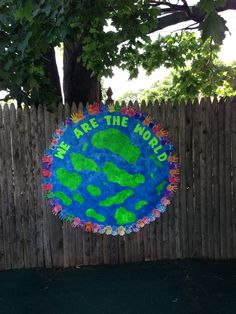'We Are the World' graduation theme with handprints from all the kids in the school