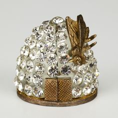 There's just something about the shape of a beehive!  Vintage crystal bee and hive pin