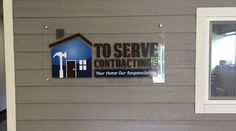 Lobby sign for a contractor - their business office looks like the outside of a house!