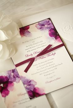 Purple Watercolor Wedding Invite. Wedding Paper Divas created a plum-hued floral watercolor invitation suite for a formal city wedding.