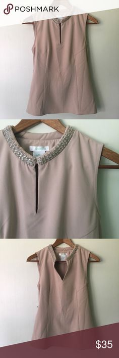 "Esley // Embellished High Neck Top - blush A great evening wear top from Esley. High neckline with beading all around. Hook and eye closure on the front, when closed creates a lovely keyhole. Fitted shape with a hidden side zipper. Thick material and a belt across the back. A slight blush and nude colored top. Has been worn, in great condition.   Measurements (approx): Bust 32"" Waist 29"" Hips 38"" Length 23"" Esley Tops Blouses"