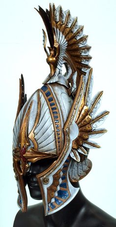 very Vanyarin, lots and lots of painted leather on a steel base \\ High Elf Helmet by Valimaa