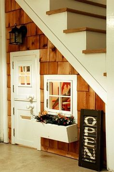 A play house under the stairs. If I ever live in a house with stairs. Oh, and this play house would be for me. Under Stairs Playhouse, Space Under Stairs, Indoor Playhouse, Inside Playhouse, Closet Playhouse, Childs Playhouse, Under The Stairs, Toddler Playhouse, Indoor Forts