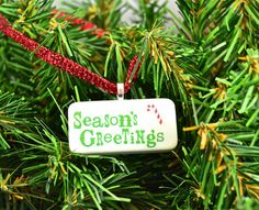 Season's Greetings Domino Christmas Ornament on Etsy, $8.00