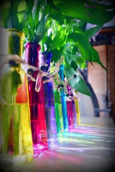 I like the idea of using plant starters in the colored glass bottles for center pieces/favors