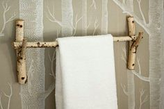 Ways to Give Your Home a Personal Stamp Inspired by their tree-themed wallpaper, these homeowners cut birch branches, sanded the edges, and fashioned them into a towel bar—and a matching handle for the plunger. Tree Themed Wallpaper, Birch Tree Wallpaper, Diy Door Knobs, Small Bathroom Organization, Bathroom Hacks, Diy Casa, Towel Hanger, Towel Rod, Towel Bars
