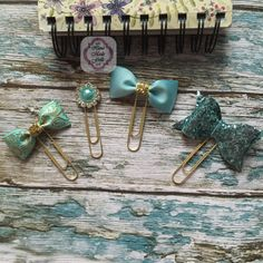 Check out this item in my Etsy shop Paper clip,Planner supplies, handmadefrills spring ,planner stickers ,stationery  ,erin condren, Filofax ,robins egg blue, tiffany blue ,planner clip https://www.etsy.com/uk/listing/262356556/tiffiany-blue-n-gold-planner-book-mark
