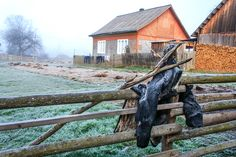 A cloth waiting to dry outside of a villagers home in Ucraine Garden Bridge, Waiting, Outdoor Structures, Cabin, House Styles, Places, Clothes, Home Decor, Outfits
