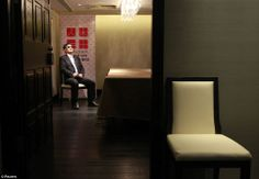 Chinese dissident Chen Guangcheng prepares himself before an interview with Reuters in Taipei June 24./Reuters