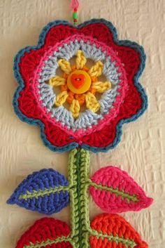 Happy flower from http://attic24.typepad.com/weblog/crochet/  Pretty!