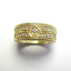 Diamond Band - The total diamond weight for this yellow gold band is 0.55ct. 115-A260 (subject to prior sale) – Lilliane's Jewelry – 4101 W. 83rd St. Prairie Village, KS 66208 – 913-383-3376 –