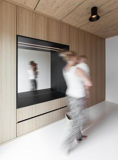 White polyurethane floors create the illusion of increased space, and add brightness and depth to the interior. A Strikingly Minimal Home Built in Less Than Six Months by Tiffany Jow Vestibule, Polyurethane Floors, German Houses, Roof Shapes, Built In Furniture, Minimal Home, Small Buildings, Built In Wardrobe, Smart Design