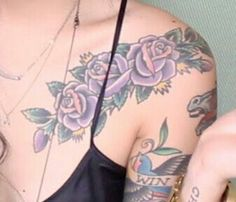 Claire Marshall's purple floral chest tattoos