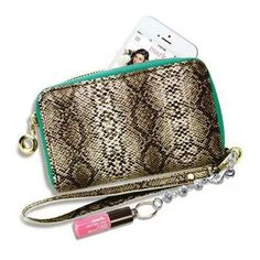"mark. Talk About Style Phone Case Wallet  With compartments to hold cash, cards plus your phone, this all-in-one, wallet-sized wristlet sends a super-stylish message even when your cell's tucked inside. Mini Glow Baby Glow in shade Pink Crush attached. Textured snakeskin print. Imported. 5 3/4"" W x 3 1/2"" H x 1"" D.  (To order visit www.youravon.com/fredbrown)"