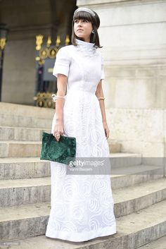 Jewelry designer Alexandra Purcaro poses wearing a vintage dress and I dont have a sister necklace and bracelets before the Alexis Mabille presentation at the Opera Garnier on July 8, 2015 in Paris, France.  (Photo by Vanni Bassetti/Getty Images) http://elfashion.de/2015/08/street-style-paris/
