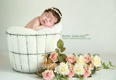 Bebê recém nascido em foto newborn