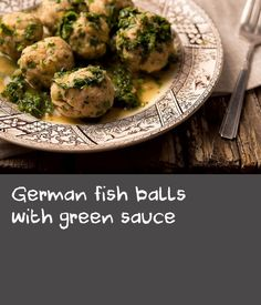 German fish balls with green sauce | This dish makes for a lovely, light supper. The fish is moist and almost bouncy, the sauce an equal combination of buttery goodness, tangy creaminess from the sour cream and a rat-a-tat jolt of the various bitter-sweet-aromatic herbs as you taste each one. As a main course, I'd serve this with new potatoes or bread. But it'd be fantastic alone as a summertime starter.