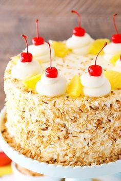 This Pina Colada Layer Cake has moist layers of coconut cake, homemade pineapple filling and coconut frosting! Topped with toasted coconut, cherries and pineapple for a tropical treat that screams spring! Bolo Charlotte, Coconut Pineapple Cake, Pineapple Filling For Cake, Pina Colada Cake, Cake Recipes, Dessert Recipes, Easy Desserts, Coconut Frosting, Coconut Cakes