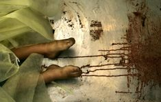 """The feet of one of three Palestinian siblings from the Al-samoni family, killed by an Israeli tank shell, are seen in the mortuary of Al-Shifa hospital, on January 5, 2009 in Gaza City. Seven members from the Al-samoni family were killed including the mother, three children and a baby, when an Israeli shell struck their house south of Gaza city."""""""