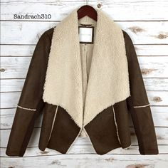 Brown faux suede shearling coat Brand: Maurices  Size: M New(no tags)  Color: Brown  Faux sherpa lining  Open front  Shawl collar  Long sleeve  Pockets  No Swap Jackets & Coats