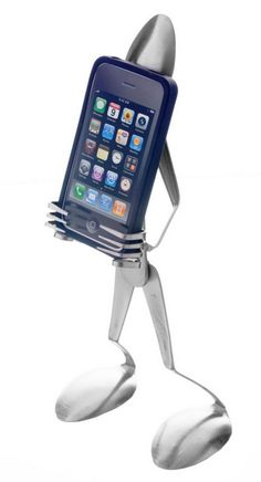 #iphone #diy #projects iPhone Stand Made from Fork and Spoon  check out this IPhone Tips and Tricks Guide:   http://www.universalthroughput.com/interest/index.php?item=533   Looking for some groovy art phone cases by an emerging artist? check here: http://www.universalthroughput.com/site2/phonecases.php    }