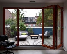 It would be lovely to have a deck outside the master bedroom -- I love the glass doors!
