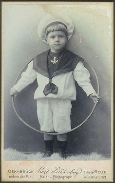 German boy in sailor suit with hoop.