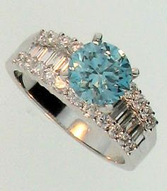 Carolina blue engagement ring? too many diamonds for me but the color of the diamond is gorgeous