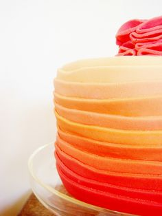 orange ombre cake. I like the colours, but the fondant looks grossly thick.