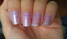 Light pearl shimmery base with lilac checkered pattern stamped on.