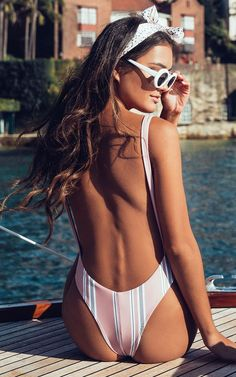 This stylish one piece swim suit features a plunging open back and armhole to reveal a bit of side boob!