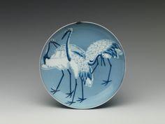 青磁染付鶴文皿 Dish with CranesPeriod: Edo period (1615–1868)Date: late 17th centuryCulture: JapanMedium: Porcelain with celadon and iron glazes and underglaze blue decoration (Hizen ware, Nabeshima type)The Met