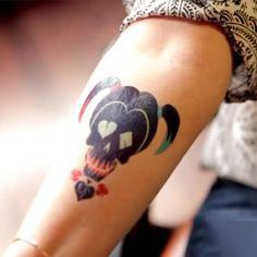 Ha Ha Harley Quinn Symbol Tattoo On Bicep