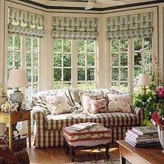 I would love to own this living room.  I love the use of patterns, the floor to ceiling windows.....love it all!