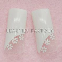 Airbrushed False Nail Tips x 70pcs - WHITE FLOWERS (#E162Nails) CODE: #E162Nails by Beauties Factory. $8.99. Airbrushed False Nail Tips x 70pcs - WHITE FLOWERS (#E162Nails) 100% Brand new in Retail box package From size 1 to size 10, 7 pieces for each size Package with hard clear box Same design for each size Make Beautiful Nails within minutes Suitable for professional or home use Free gift : one piece of nail glue for sample try