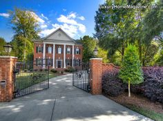 Dramatic Gated Brick Estate in Charlotte, NC #luxury #homes #house #architecture #entrance #driveway #entry #design
