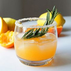 Winter Sun Cocktail juice of 2 clementines (about cup) juice of small lemon oz) oz triple sec 1 oz vodka sprig of rosemary lemon zest sugar Holiday Drinks, Holiday Cocktails, Fun Drinks, Yummy Drinks, Sweet Cocktails, Beverages, Winter Drinks, Holiday Parties, Cocktail Juice