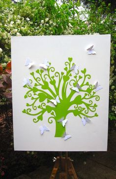 Dies ist ein Gästebuch,das man sich gerne aufhängt und die Lieben einen stets an den schönsten Tag im Leben erinnern.Unser herziger Baum ist auf ei...