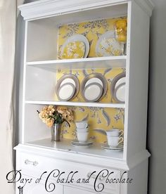 This repurposed china cabinet is stinkin' cute!  Check out the before!  I'm a sucker for yellow and gray and this is done beautifully.  Found at http://daysofchalkandchocolate.blogspot.com/2012/03/project-sneak-peak.html