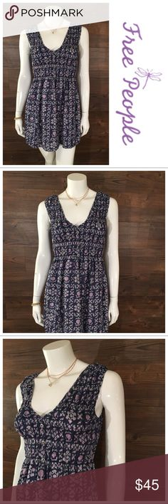 3185f5f80b509 Free People Floral Dress This navy Free People tank dress has a beautiful  lavender floral print and v-neckline. Dress is silk with faux button  details on ...